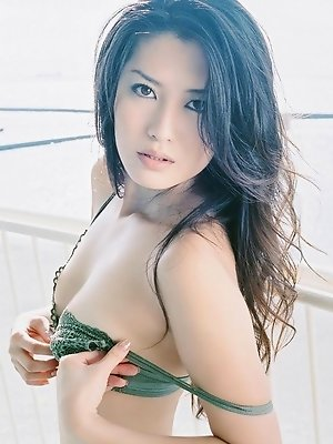 Radiant asian beauty looks incredible in her lace lingerie