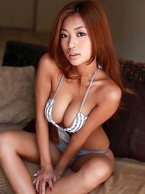 Kana Tsugihara Asian with huge hooters poses so sexy in bath suit