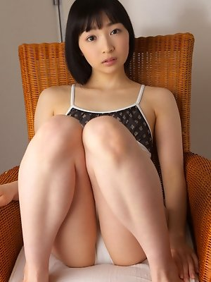 Kotone Moriyama Asian rubs her vagina in bath suit of chair edge