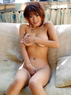 Asian tramp in stockings spreads her legs for an excellent open legs pussy shot