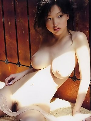 Captivating naked gravure idol with large soft plump breasts