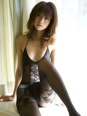 Gravure asian babe is incredibly adorable in her skimpy lingerie