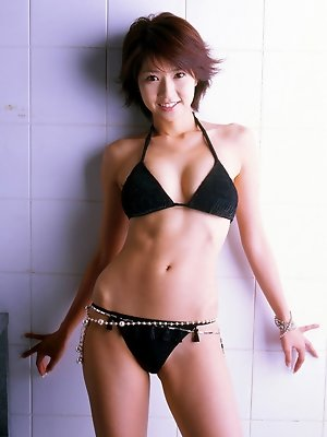 Beautiful short haired asian angel looks delicious in her bikini